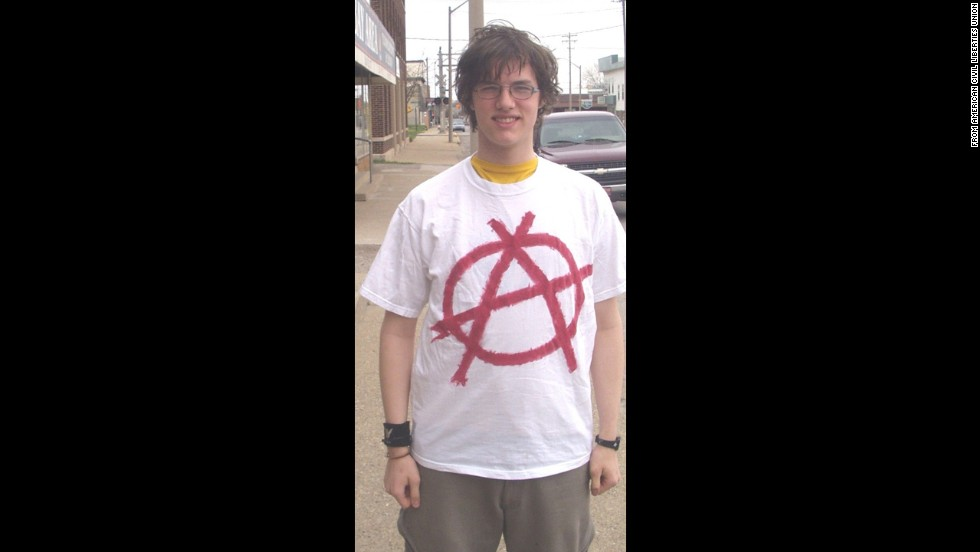 "In 2004, Timothy Gies, a senior at Bay City Central High School in Michigan, was <a href=""http://www.cnn.com/2005/US/08/12/style.rules/"">suspended several times</a> for wearing shirts and sweat shirts with anarchy symbols, peace signs, upside-down American flags and an anti-war quote from Albert Einstein."
