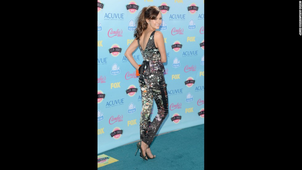 Actress Nina Dobrev shows off her outfit as she arrives.
