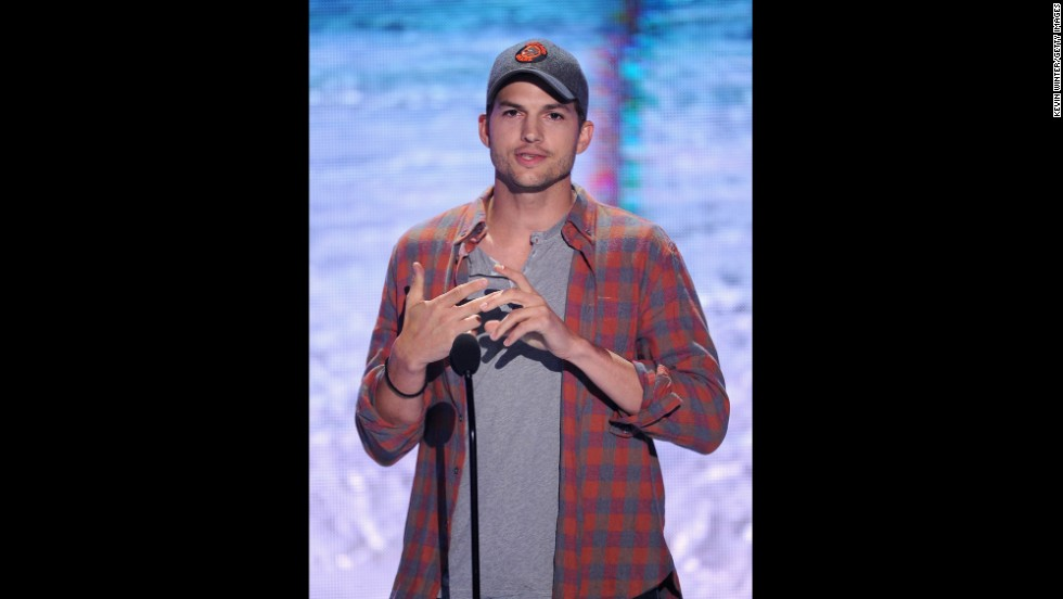 Ashton Kutcher speaks onstage during the show.