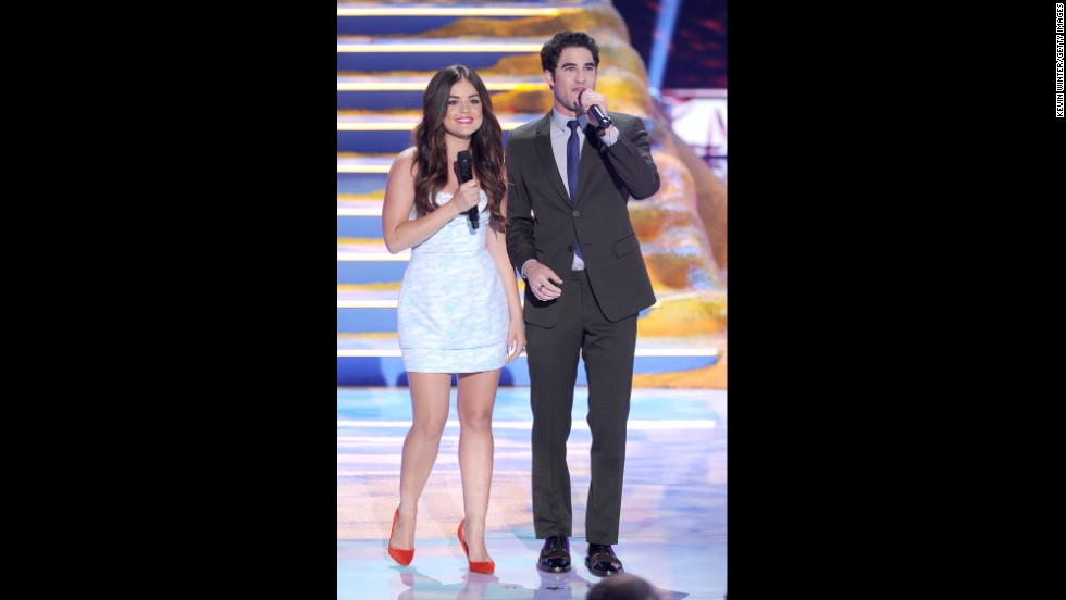 Co-hosts Lucy Hale and Darren Criss greet the audience.