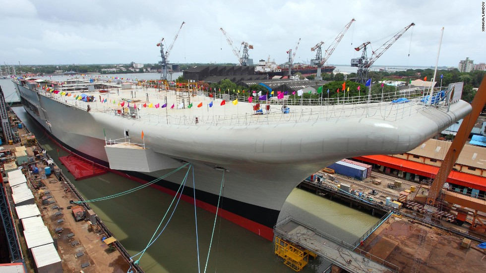 The INS Vikrant docks at the Cochin Shipyard on Sunday, August 11. It can carry MiG 29K fighters and light combat aircraft, a defense spokesman says.