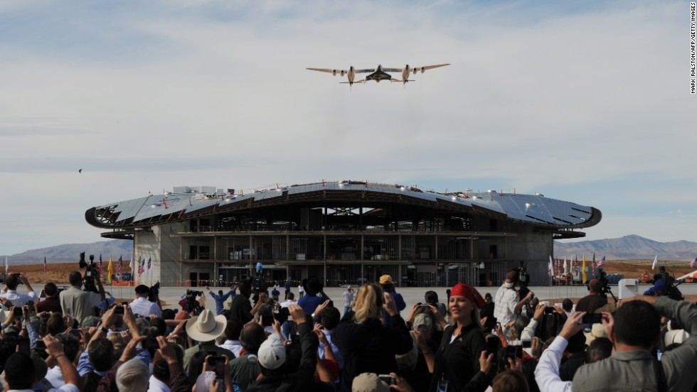 The Virgin Galactic VSS Enterprise spacecraft flies over its hanger before its first public landing during the Spaceport America runway dedication ceremony near Las Cruces, New Mexico, on October 22, 2010.