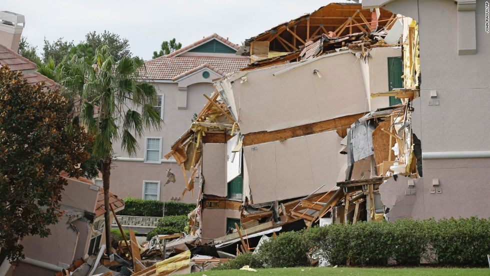 """A <a href=""""http://www.cnn.com/2013/08/12/us/florida-resort-sinkhole/index.html?hpt=hp_t2"""" target=""""_blank"""">60-foot-wide sinkhole</a> formed under a resort in central Florida late on Sunday, August 11, forcing guests out of their rooms as one three-story building collapsed and another slowly sank."""