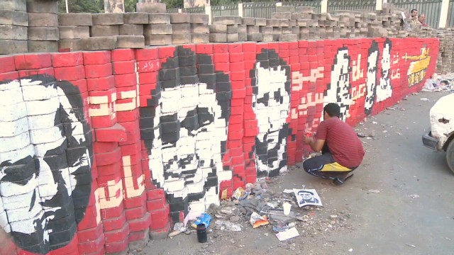 Morsy supporters rally despite threat