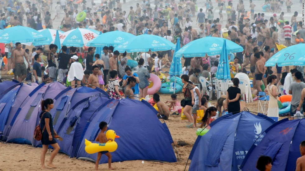People flock to the beach in Qingdao, China, on Sunday, August 11.