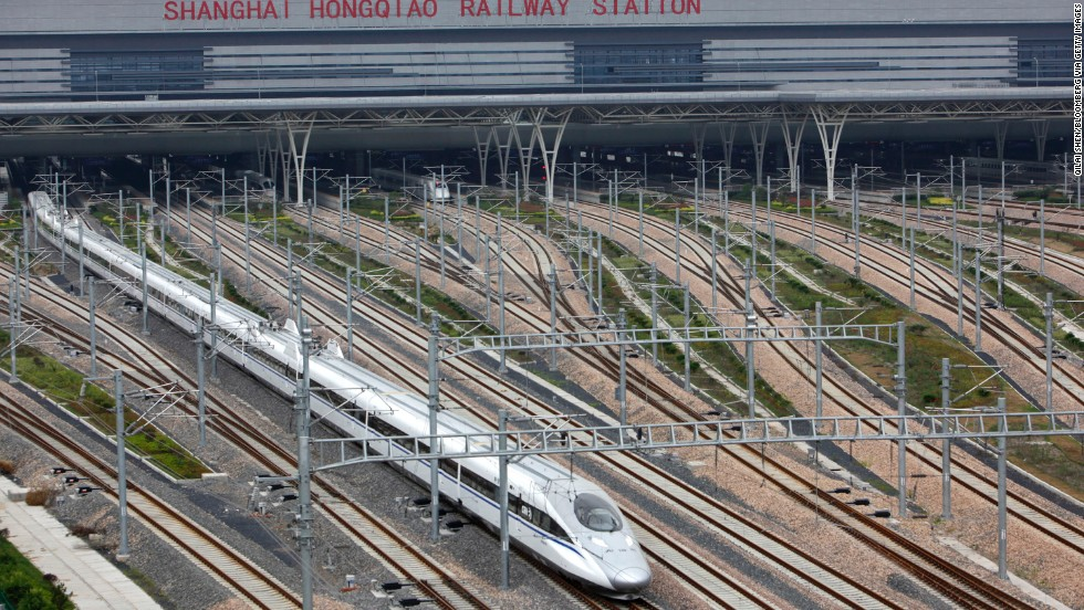 A CRH380A bullet train pulls out of the Hongqiao Station during one of its test runs in 2011 on the Beijing-Shanghai high-speed railway in China. The CRH380A has topped out at 302 mph and routinely runs at 217 mph.
