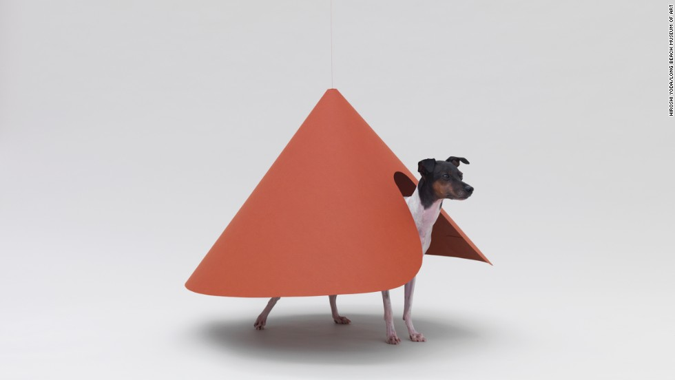 "The Hara Design Institute's ""Pointed T"" is built specifically for a Japanese Terrier. The curved opening in the suspended cone allows the dog to enter and exit the house."