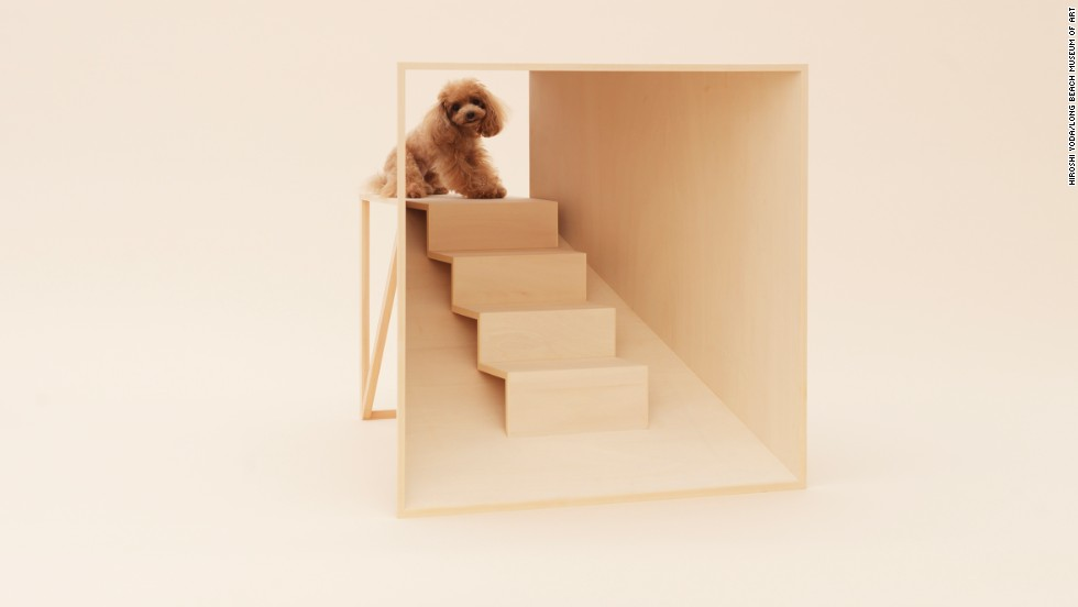 "Kenya Hara's ""D-Tunnel"" is especially designed for a teacup poodle. When the poodle enters the house, he climbs stairs to a platform, allowing him to see from a much higher point of view."