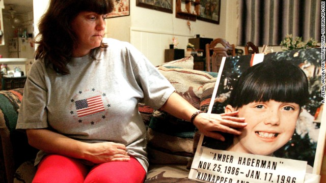 Donna Norris touches a photograph of her daughter, Amber Hagerman, at her Hurst, Texas, home. The 9-year-old's body was found a few days after she'd been kidnapped. A public alert system was named for the Arlington girl.