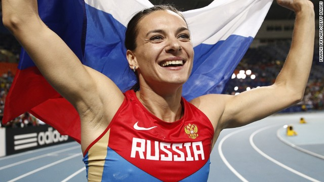 Golden girl: Yelena Isinbayeva celebrates her victory in the World Championship pole vault in Moscow.