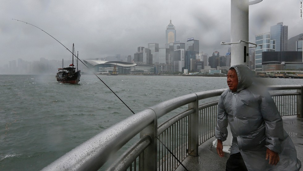 "A fisherman battles a strong wind at Hong Kong's Victoria Habour on August 13. Typhoon Utor intensified as it moved toward the southern coast of China. The storm <a href=""http://www.cnn.com/2013/08/12/world/asia/typhoon-utor/index.html"">battered the northern Philippines</a> on Monday, killing at least one person and leaving 20 fishermen missing."