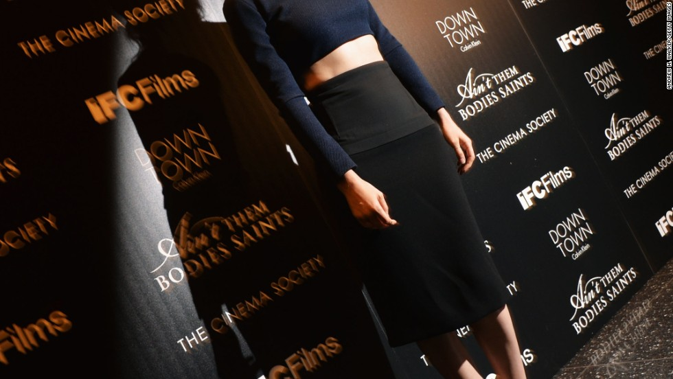 "Rooney Mara bares a bit of her belly at a screening for her film ""Ain't Them Bodies Saints"" on August 13."