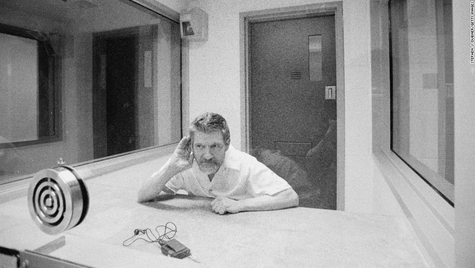 "Domestic terrorist, Luddite, and mathematics teacher Ted Kaczynski cups his hand to his ear during an interview at the Federal Administrative Maximum Facility prison in Florence, Colorado, on August 30, 1999. Kaczynski, known to the public as the ""Unabomber,"" planted and mailed homemade bombs between 1978 and 1995, killing three people and injuring 23 others."