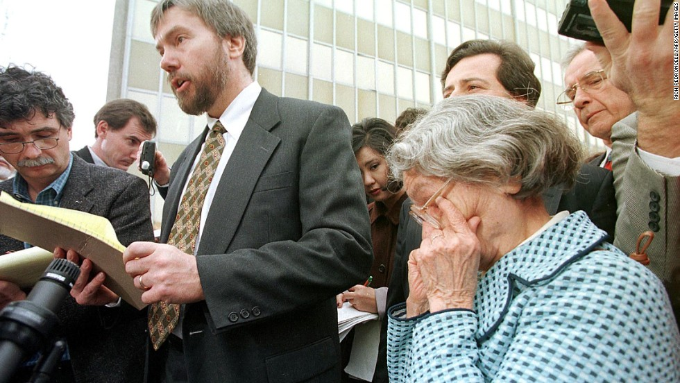 David Kaczynski, brother of Ted Kaczynski, speaks to the media as his mother Wanda wipes away tears after Ted Kaczynski admitted he was the Unabomber, pleading guilty to all counts on January 22, 1998, in Sacramento.