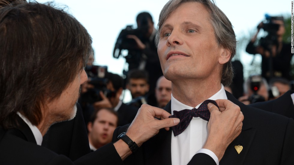 Brazilian director Walter Salles, left, adjusts Viggo Mortensen's bow tie at the 65th Cannes film festival in May 2012. Moretensen is 56.