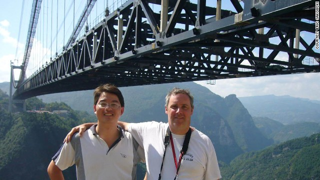 Eric Sakowski, right, and Chinese bridge engineer Shijie Du, at China's Sidhue River Bridge, the world's highest.