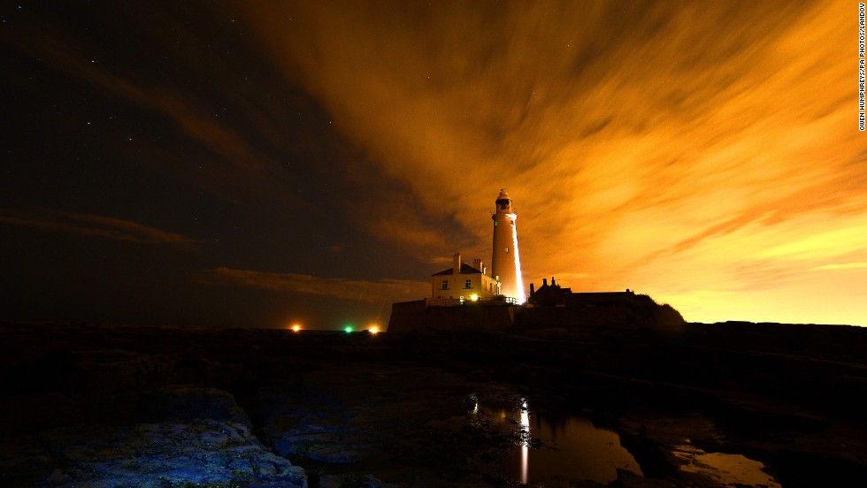 A starry sky is seen over St. Mary's Lighthouse, just north of Whitley Bay off the coast of Northeast England, in the early hours of the morning on August 14.