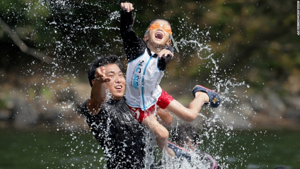 "Family members cool off in the river in Shimanto, Japan, on August 14. The temperature reached 41 degrees Celsius (105.8 degrees Fahrenheit) in the city in southern Japan and <a href=""http://www.cnn.com/2013/08/13/world/asia/asia-heat/index.html"">set a new national record</a>, according to the Japanese Meteorological Agency."