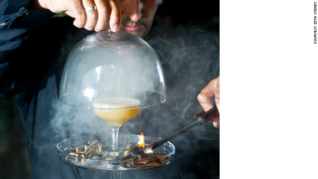 "Gin is infused with with ""gunpowder flavors"" and shaken with fernet branca and egg white."