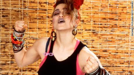 Madonna's look in 1984 - layered tops, dark makeup and bracelets, bracelets and more bracelets.