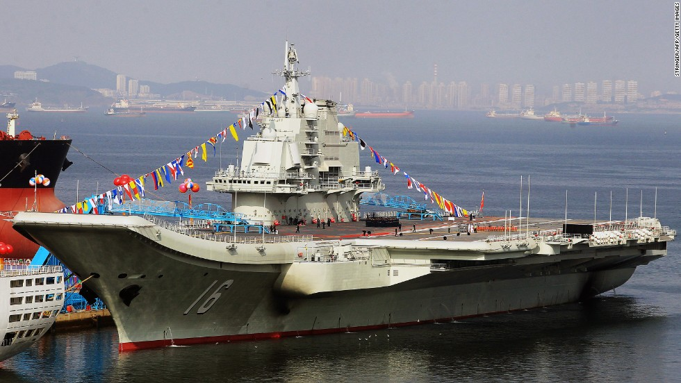 China's first aircraft carrier,  former Soviet carrier  Varyag, docked after its handover to the People's Liberation Army (PLA) navy in Dalian, northeast China's Liaoning province in 2012. China says the aircraft carrier is a training vessel, but analysts say the ship is a valuable asset in its ambition to gain a blue-water navy.