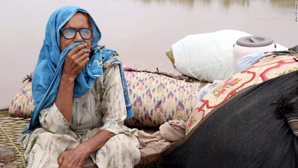 A woman affected by flooding waits for relief near Multan, Pakistan, on August 16.
