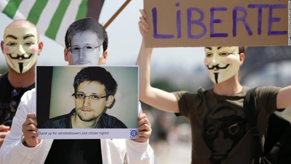 "Supporters of Snowden at a demonstration in Paris. ""We can't ignore the threat to our civil liberties by giving the government vast powers any more than we can ignore the fact that we live in a dangerous world,"" says Neil Richards."