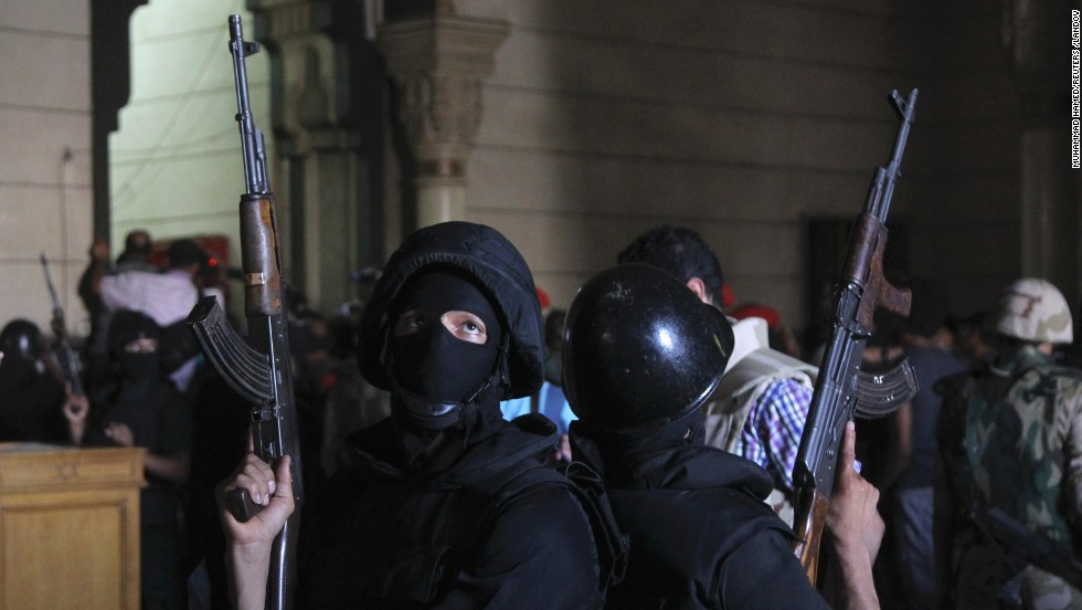 Policemen stand guard inside a room of Al-Fateh mosque as supporters of ousted president Mohamed Morsy exchange gunfire with security forces inside the mosque in Cairo on Saturday, August 17, 2013.