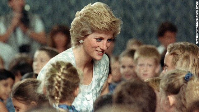 Diana listens to children during a visit to the British international school in Jakarta, Indonesia on November 6, 1989.