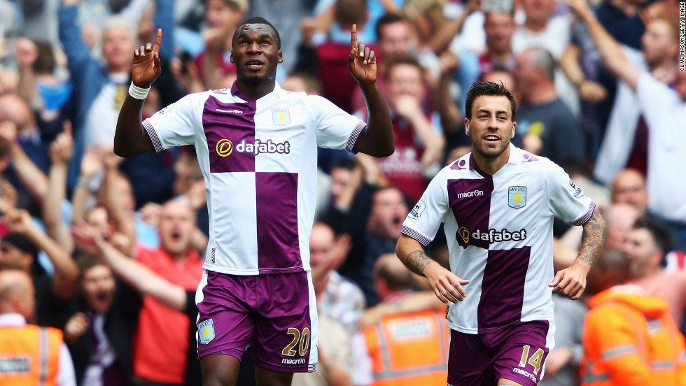 Aston Villa's Christian Benteke celebrates scoring his second goal from the penalty spot. Teammate Antonio Luna (right) scored a late third to send Arsenal crashing to an opening day 3-1 defeat at the Emirates.