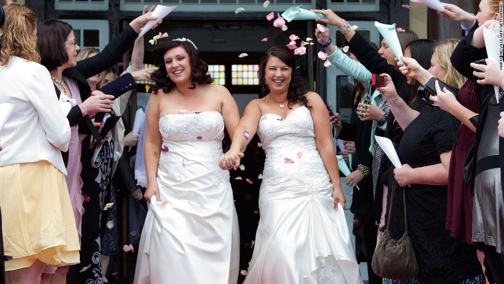 Rachel Briscoe, left, and Jess Ivess from the Bay of Islands celebrate during the first same-sex marriage at the Rotorua Museum in Rotorua, New Zealand, on Monday, August 19 -- the first day such marriages were legal in New Zealand.