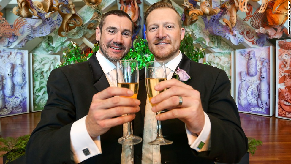 Australians Paul McCarthy (L) and Trent Kandler (R) celebrate after their marriage at the Museum of New Zealand Te Papa Tongarewa in Wellington on August 19.  The couple was flown over by Tourism New Zealand.