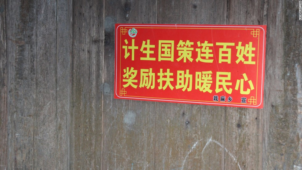 Propaganda slogans are commonplace in Chinese villages to encourage people to comply with government policies. This one reads: State family planning policy connects everyone. Rewards and subsidies warm the heart of the people.""