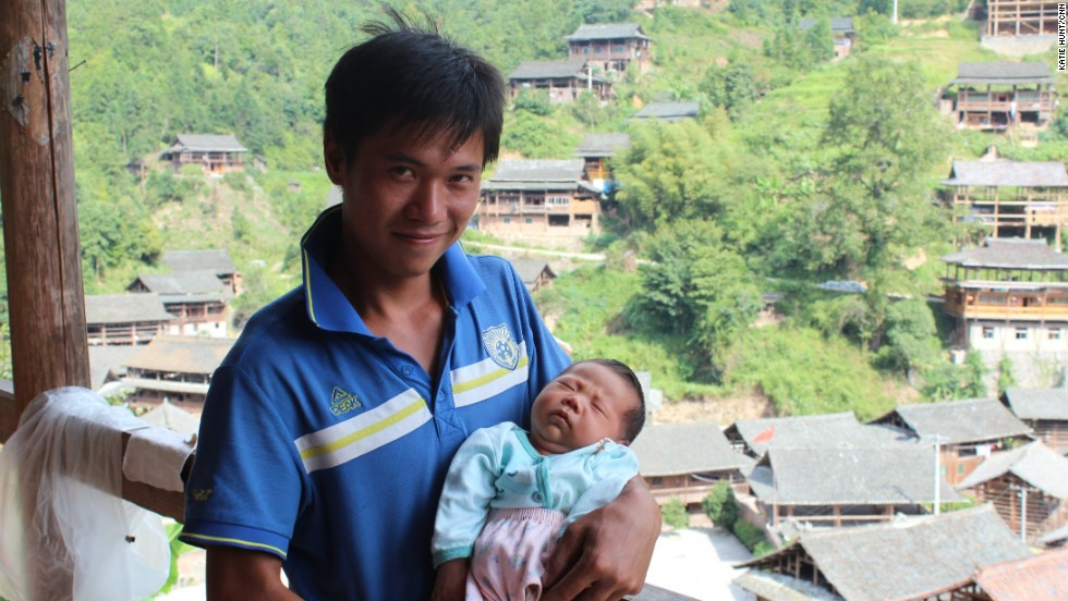 Like many young men in the village, Shi Tao is a migrant worker. He has returned home from the southern factory town of Dongguan for the birth of his first child but will soon leave again.
