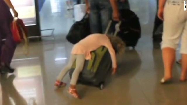 newday sleepy kid on suitcase_00001407.jpg