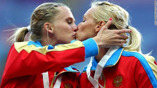 Tatyana Firova and Kseniya Ryzhova of Russia kiss on the podium during the medal ceremony.