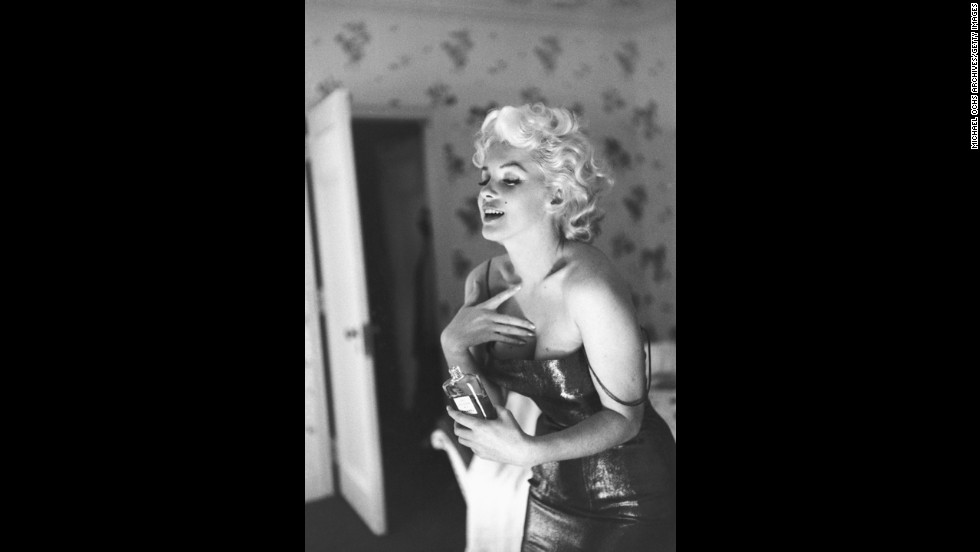 "Marilyn Monroe poses with Chanel No. 5 at the Ambassador Hotel in New York City in 1955. When asked what she wore to bed in a April 1952 LIFE magazine article, she famously responded, <a href=""http://www.youtube.com/watch?v=Wo8UtWiYiZI"" target=""_blank"">""Just a few drops of Chanel No. 5.""</a>"