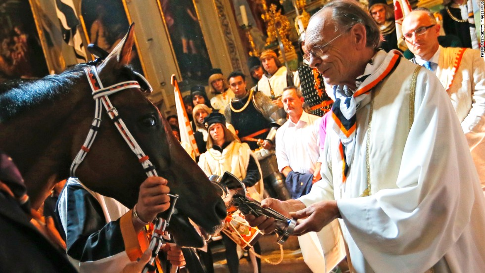 Before the Pailo di Siena riders make their 90-second dash around the city, each horse is blessed by a priest for the race which dates back to the 17th Century.