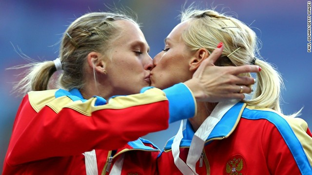 (L-R)Gold medalist Tatyana Firova and Kseniya Ryzhova of Russia kiss on the podium during the medal ceremony for the Women's 4x400 metres Relay during the IAAF World Athletics Championships Moscow.