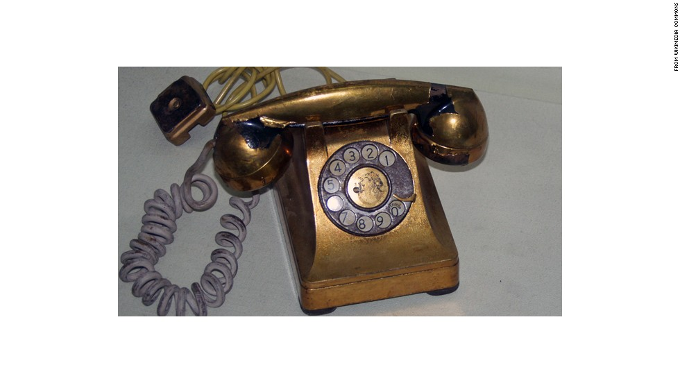 "As you can see, gold-colored phones have been around since long before Apple was born. A U.S. telecom company famously gave <a href=""http://en.wikipedia.org/wiki/Golden_Telephone"" target=""_blank"">this ceremonial golden phone</a> to Cuban dictator Fulgencio Batista in 1957, an event depicted in ""The Godfather: Part II."" The phone is now on display in a Havana museum."