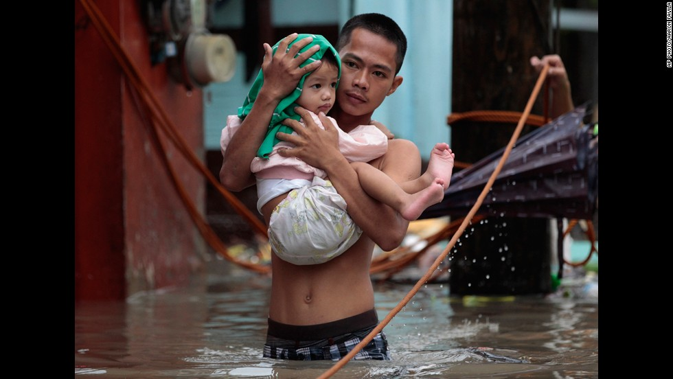 "AUGUST 20 - LAS PINAS, PHILIPPINES: <a href=""http://cnn.com/2013/08/20/world/asia/philippines-floods/index.html?hpt=hp_t3"">Ferocious rain has caused heavy flooding in the Philippines capital of Manila</a> and the surrounding region, killing at least seven people, driving tens of thousands of others from their homes and bringing life to a standstill in many areas."