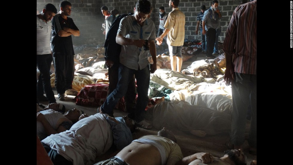Syrian rebels claim pro-government forces used chemical weapons to kill citizens outside Damascus on Wednesday, August 21. People inspect bodies in this photo released by the Syrian opposition Shaam News Network.
