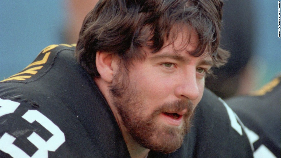 "The death of 36-year-old Pittsburgh Steelers offensive lineman Justin Strzelczyk put the link between playing football and CTE in the national spotlight. Strzelczyk was <a href=""http://www.nytimes.com/2007/06/15/sports/football/15brain.html"" target=""_blank"">killed in 2004</a> in a car crash after a 40-mile high-speed chase with police in New York."