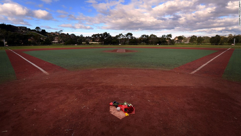 Flowers and a baseball lay on the Essendon Baseball Club's home plate as a tribute to Lane in Melbourne, Australia, on Wednesday, August 21.