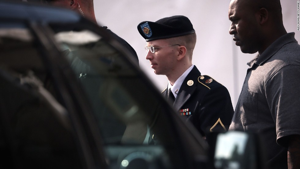Manning was convicted in July on 20 of the 22 charges against him, including violations of the U.S. Espionage Act. Here, Manning is escorted from court on June 3, 2013, at Fort Meade.