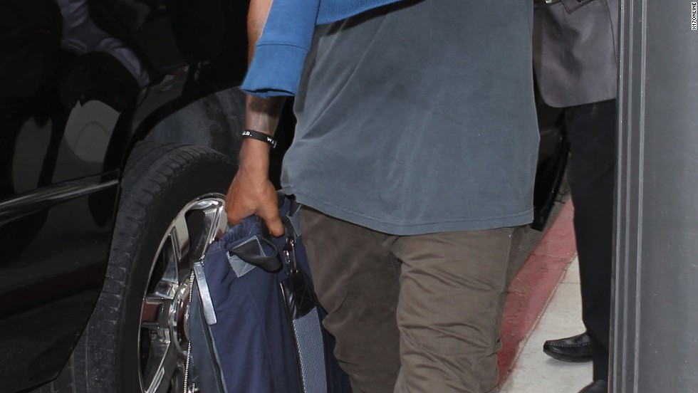 Kanye West has his hands full in Santa Monica, California on August 19.