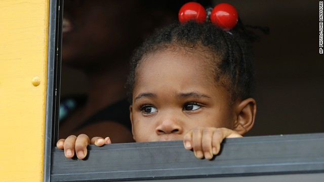 A child peers out the window of a school bus as buses arrive with students after an incident at Ronald McNair Discovery Learning Academy, on August 20, 2013 in Decatur, Georgia.