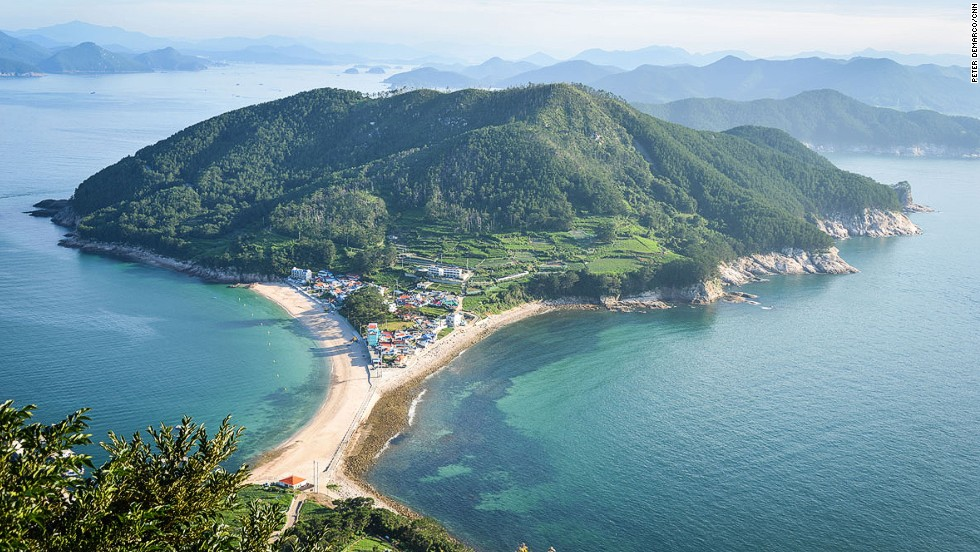 A powdery strip of white sand tethers two ends of Bijindo island together. The top of Waesan Mountain offers this great view of the island and surrounding marine park.