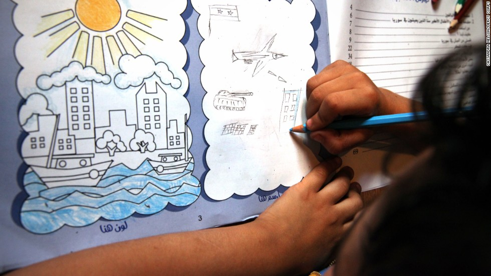 Ibrahim, 6, draws violent and painful pictures of his memories of Syria in his workbook. The workbook is carefully designed to help children tell their story and effectively cope with stress related to the conflict. Mercy Corps says trained psychosocial workers supervise the activities.