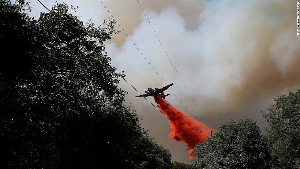 An air tanker drops fire retardant on a ridge ahead of the advancing Rim Fire on August 22, in Groveland, California. The Rim Fire continues to burn out of control and has entered Yosemite National Park.